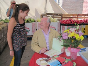 CBS Anchor and Tallgrass Beef founder Bill Kurtis signs copies of The Prairie Table cookbook as part of City Fresh Market's 7th Anniversary Celebration.